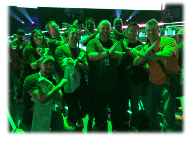 Group of gamers at Xbox FanFest and E3 holding up arms in the shape of an X for Xbox