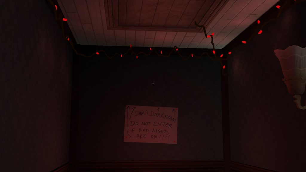 Image of red twinkle lights under and attic door with a sign that reads, do not enter if lights are on