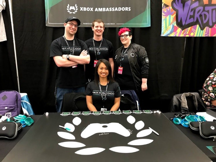 The four Xbox Ambassadors Community Managers posing behind the PAX East table.